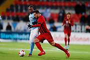 OSTERSUND, SWEDEN - MARCH 17: Carlos Strandberg of Malmo FF and Sotirios Papagianopoulos of Ostersunds FK during the Swedish Cup Semifinal between Ostersunds FK and Malmo FF at Jamtkraft Arena on March 17, 2018 in Ostersund, Sweden. Photo: Nils Petter Nilsson/Ombrello ***BETALBILD***