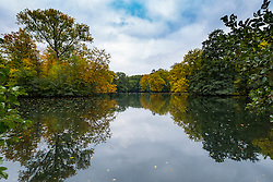 View of lake and trees in Autumn in Tiergarten park in Berlin Germany