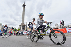 © Licensed to London News Pictures. 29/07/2017. London, UK. Members of the public ride through Trafalgar Square during the Prudential RideLondon FreeCycle, around an 8 mile course in the centre of the capital, taking in in iconic landmarks en route.  The event is part of Prudential RideLondon's three day celebration of cycling with over 100,000 people participating over the weekend..   Photo credit : Stephen Chung/LNP