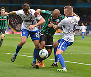 Rochdale Forward, Calvin Andrew tries to get the ball through Bury defender Danny Pugh and Bury Defender Peter Clarke during the Sky Bet League 1 match between Bury and Rochdale at Gigg Lane, Bury, England on 17 October 2015. Photo by Mark Pollitt.