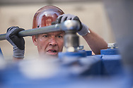 20170520, Saturday, May 20, 2017, Boston, MA, USA; O.B. Hill's Randy Curtis, of Brockton, unbolts the MRI from it's traveling cradle. Various technical medical installation specialties, lead by the team from O.B. Hill Trucking and Rigging, descended on and into the Brigham Building for Transformative Medicine to deliver only the third &ldquo;7T&rdquo; (MAGNETOM Terra) Siemens MRI in the United States into it&rsquo;s predesigned location inside the L2 portion of the advanced research building on 60 Fenwood Road.<br /> Using a crane and plenty of elbow grease and smarts the massive 22 ton unit was lifted through the morning air and lowered through a large access hole into the innards of the building Saturday morning.<br /> <br /> For more information, please contact Haley Bridger, hbridger@bwh.harvard.edu, office: 617-525-6383 cell: 978-807-5302<br /> <br /> ( 2017 &copy; lightchaser photography )