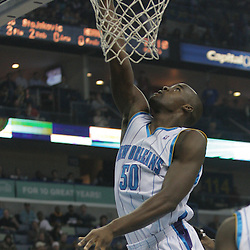 Nov 19, 2009; New Orleans, LA, USA; New Orleans Hornets center Emeka Okafor (50) tips in the ball for a score against the Phoenix Suns during the first half at the New Orleans Arena. The Hornets defeated the Suns 110-103. Mandatory Credit: Derick E. Hingle-US PRESSWIRE