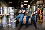 MADISON, WI -JUNE 2, 2015: Andrew Gierczak, left, and Henry Schwartz, two of the three founders of MobCraft Brewery in Madison, Wisconsin, sit for a portrait June 2, 2015. MobCraft uses crowdfunding to determine what they will be making each month. Lauren Justice for The New York Times