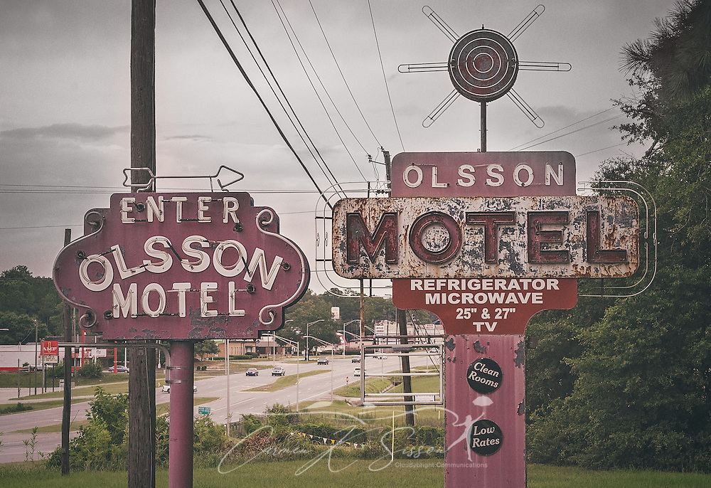 Rusted signs advertise the Olsson Motel on Highway 90, July 10, 2016, in Mobile, Alabama. (Photo by Carmen K. Sisson/Cloudybright)