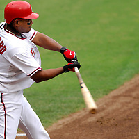 18 July 2007:  Washington Nationals second baseman Ronnie Belliard (10) hits an RBI double that scored catcher Jesus Flores (3) in the 2nd inning against Houston Astros' Jason Jennings.  The Nationals defeated the Astros 7-6 at RFK Stadium in Washington, D.C.  ****For Editorial Use Only****