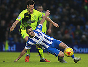 Brighton central midfielder Beram Kayal gets the better of Huddersfield Town defender Mark Hudson during the Sky Bet Championship match between Brighton and Hove Albion and Huddersfield Town at the American Express Community Stadium, Brighton and Hove, England on 23 January 2016. Photo by Bennett Dean.