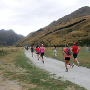 Runners head off into the Ben Lomond High Country Station during the Pure South Shotover Moonlight Mountain Marathon and trail runs. Moke Lake, Queenstown, New Zealand. 4th February 2012. Photo Tim Clayton