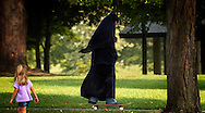 A young girl rides her skateboard through Kirby Park during the final weeks of summer.