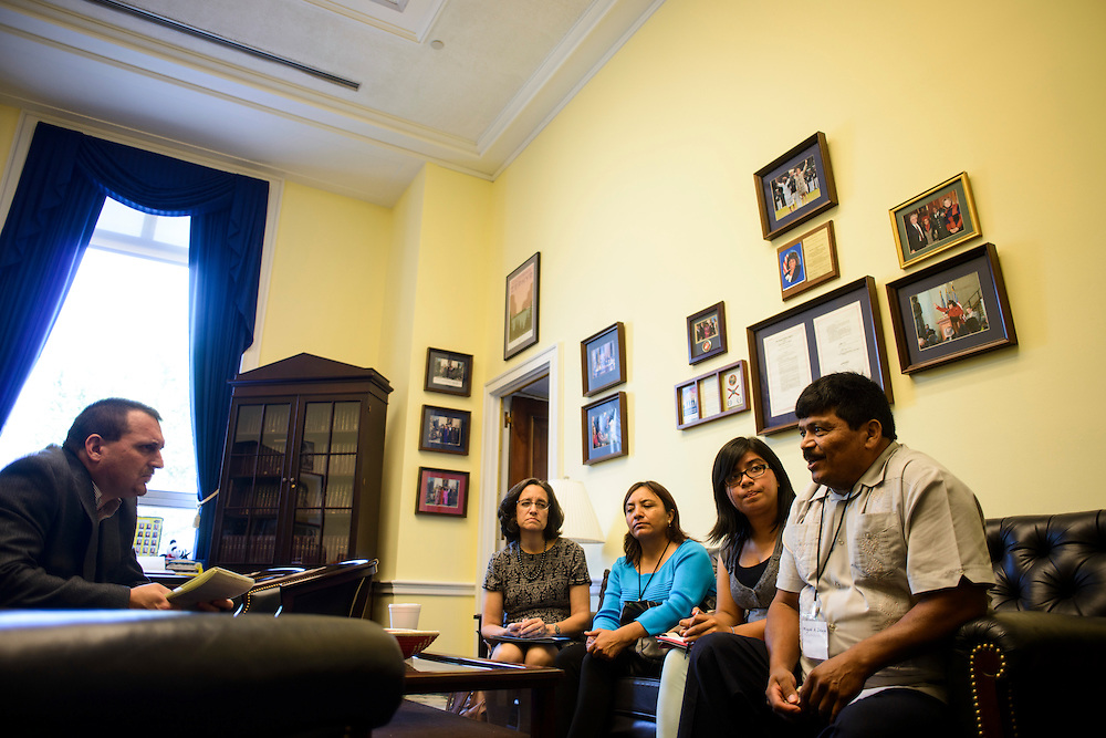 Photo by Matt Roth<br /> <br /> Virginia Ruiz, with Farmworker Justice, and Florida Farmworker Fly In constituents (L-R) Ofelia Aguilar, Selena Zelaya and her father  Miguel Zelaya, meet with Lee Footer, left, Legislative Assistant for Agriculture &amp; Environmental Policy for Rep. Corrine Brown at the Rayburn House Building in Washington, D.C. on Tuesday, July 16, 2013.