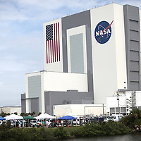 A security helicopter hovers above the Vehicle Assembly Building as Space Shuttle Atlantis lifts off from the Kennedy Space Center Friday, July 8, 2011, in Cape Canaveral, Fla. Shuttle Atlantis is the 135th and final space shuttle launch for NASA..  (AP Photo/Alex Menendez)