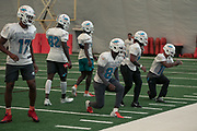 Miami Dolphins wide receivers Brice Butler (17) Preston Williams (82) Isaiah Ford (84) and fellow teammates warm up during indoor practice during training camp at the Baptist Health Training Facility at Nova Southeastern University, Friday, August 2, 2019, in Davie, Fla. (Kim Hukari/Image of Sport)