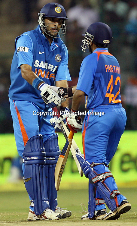 Indian batsman Yuvraj Singh congarates to batsman Parthiv Patel after make 50 during the 4th ODI match India vs New Zealand Played at M Chinnaswamy Stadium, Bangalore, 7 December 2010 - day/night (50-over match)