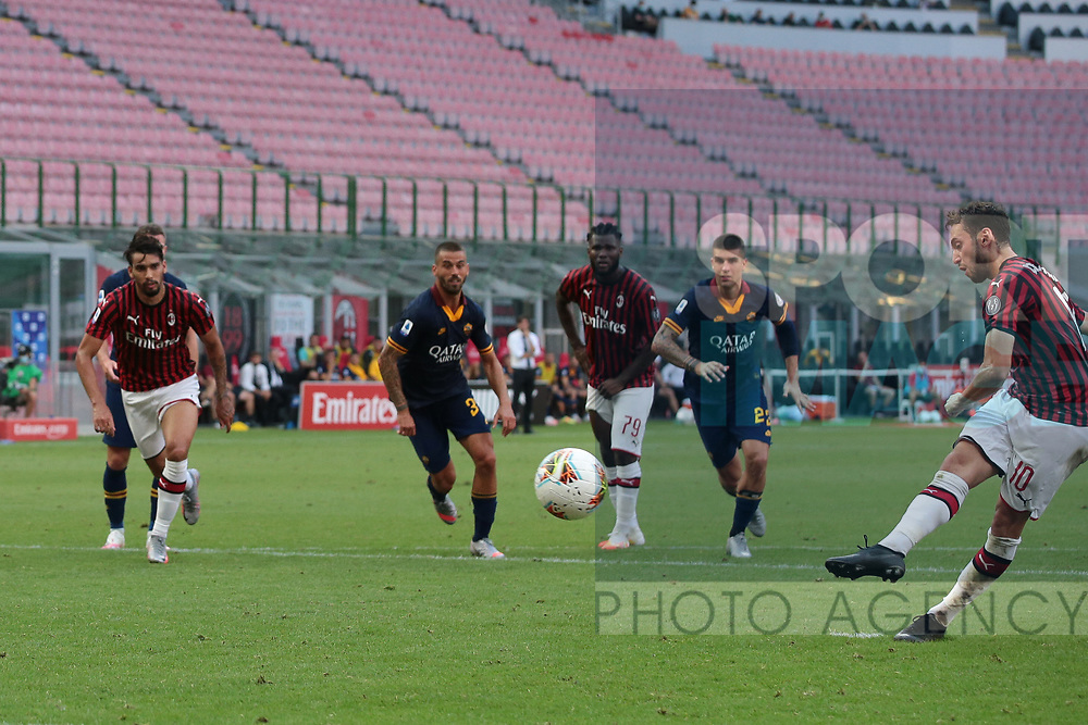 AC Milan's Turkish midfielder Hakan Calhanoglu scores from the penalty mark to give the side a 2-0 lead during the Serie A match at Giuseppe Meazza, Milan. Picture date: 28th June 2020. Picture credit should read: Jonathan Moscrop/Sportimage