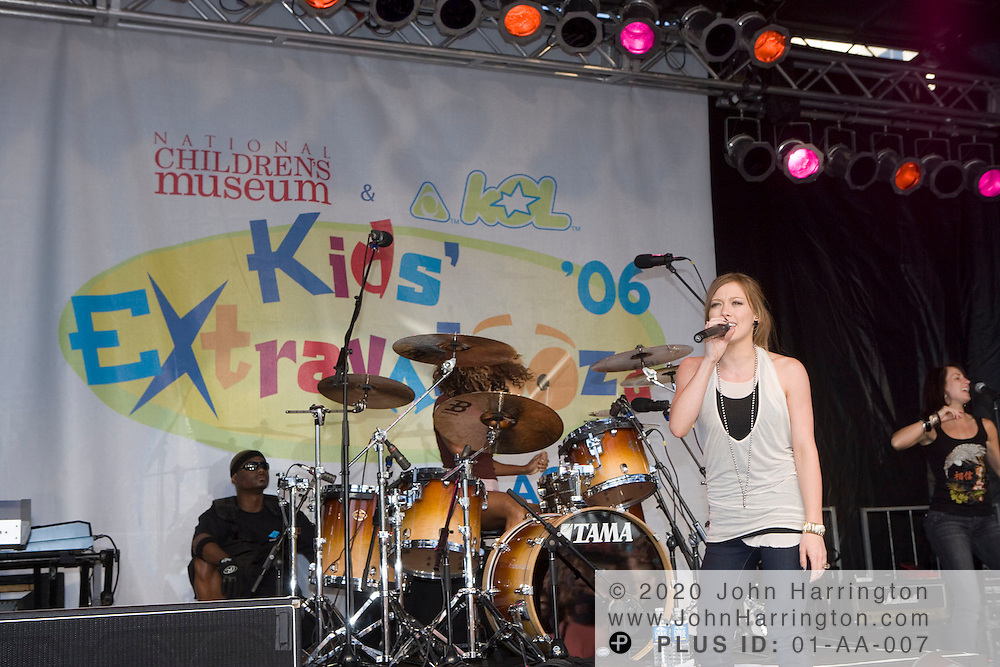 """Singer and actress Hilary Duff performs at XM on Saturday June 10, 2006.  Duff was part of XM's """"Kids' Extravalooza"""" event."""