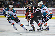 KELOWNA, CANADA - FEBRUARY 18:  Nolan Foote #29 of the Kelowna Rockets, Tomas Soustal #15 of the Kelowna Rockets, Aaron Boyd #23 of the Prince George Cougars at the Kelowna Rockets game on February 18, 2017 at Prospera Place in Kelowna, British Columbia, Canada.  (Photo By Cindy Rogers/Nyasa Photography,  *** Local Caption ***