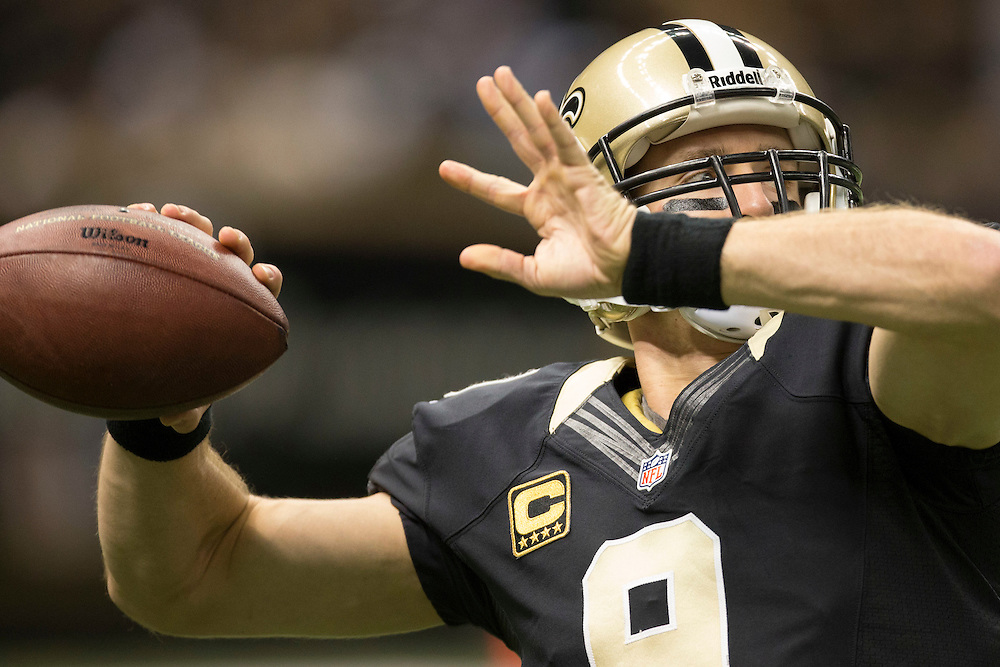 NEW ORLEANS, LA - DECEMBER 30:  Drew Brees #9 of the New Orleans Saints warming up before a game against the Carolina Panthers at Mercedes-Benz Superdome on December 30, 2012 in New Orleans, Louisiana.  The Panthers defeated the Saints 44-38.  (Photo by Wesley Hitt/Getty Images) *** Local Caption *** Drew Brees