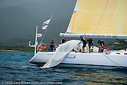 Diana, recovering their spinnaker from the ocean during Race 4 at Antigua Sailing Week.
