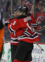 Feb 9; Newark, NJ, USA; New Jersey Devils center Adam Henrique (14) and New Jersey Devils right wing Steve Bernier (18) celebrate Henrique's goal during the second period at the Prudential Center.