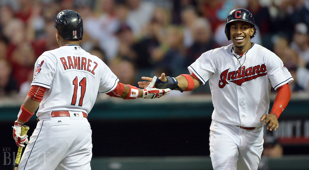 Sep 3, 2016; Cleveland, OH, USA; Cleveland Indians shortstop Francisco Lindor (12) celebrates with third baseman Jose Ramirez (11) after scoring during the third inning against the Miami Marlins at Progressive Field. Mandatory Credit: Ken Blaze-USA TODAY Sports