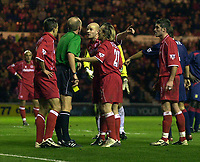 Photo. Glyn Thomas.<br /> Middlesbrough v Portsmouth. FA Barclaycard Premiership.<br /> Riverside Stadium, Middlesbrough. 06/12/2003.<br /> Boro players remonstrate with the ref after Szilard Nemeth (L) is given a yellow card for diving.