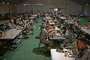 Soldiers eating during a training exercise at the National Training Center at Fort Irwin, California,