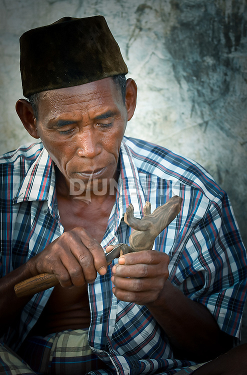Wood carving provides alternative incomeKomodo Village, Komodo National Park