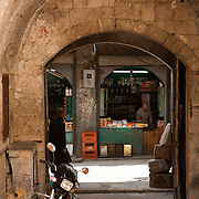 View through an archway to a Old City street, Aleppo, Syria