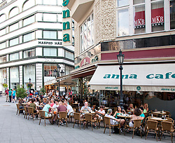Known for its coffees and cheese plates, the Anna Cafe anchors one portion of Vaci Street, a prime pedestrian shopping zone in the Pest section of Budpest, Hungary.