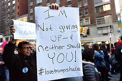 November 13, 2016 - New York City, New York, United States - New Yorkers continue to protest the election of Donald Trump as US President as some 3,000 activists gathered at Trump Tower on Central Park West to rally before marching to Trump's Fifth Avenue building. Organizers and many of the participants focused on Latin American immigrants & their concern over possible discrimination as Trump has promised to deport all illegal immigrants currently in the US. (Credit Image: © Andy Katz/Pacific Press via ZUMA Wire)