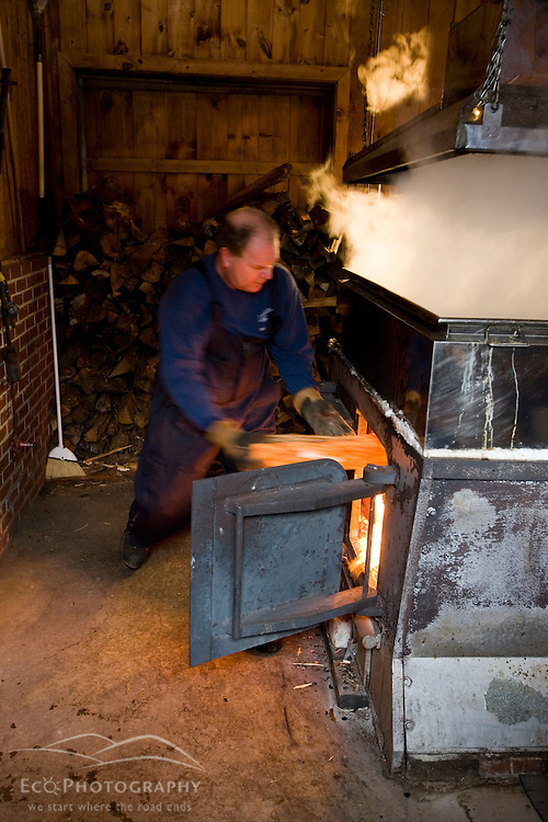 Tending the fire under a sap evaporator in a sugar house in Barrington, New Hampshire.  The Sugar Shack.