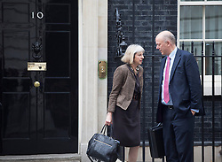 © licensed to London News Pictures. London, UK 15/10/2013. Theresa May and Chris Grayling attending to a cabinet meeting in Downing Street on Tuesday, 15 October 2013. Photo credit: Tolga Akmen/LNP