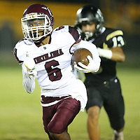 Okolona's Jacorrius Standfield outruns the Falkner defense and puts them up 7-0 over Falkner on Friday.
