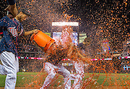 Chris Herrmann #12 of the Minnesota Twins has Gatorade dumped on him during a post-game interview after he got the walk-off base hit to defeat the Chicago White Sox on August 15, 2013 at Target Field in Minneapolis, Minnesota.  The Twins defeated the White Sox 4 to 3.  Photo by Ben Krause