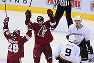 Mar. 2, 2013; Glendale, AZ, USA; Phoenix Coyotes center Steve Sullivan (26) celebrates with teammate center Kyle Chipchura (24) after scoring in the third period against the Anaheim Ducks in the third period at Jobing.com Arena. The Coyotes defeated the Ducks in a shootout 5-4. Mandatory Credit: Jennifer Stewart-USA TODAY Sports