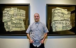 05 October 2013. New Orleans, Louisiana.<br /> Dan Tague and his Almighty Dollar bills at Jonathan Ferrara Gallery.<br /> Photo; Charlie Varley