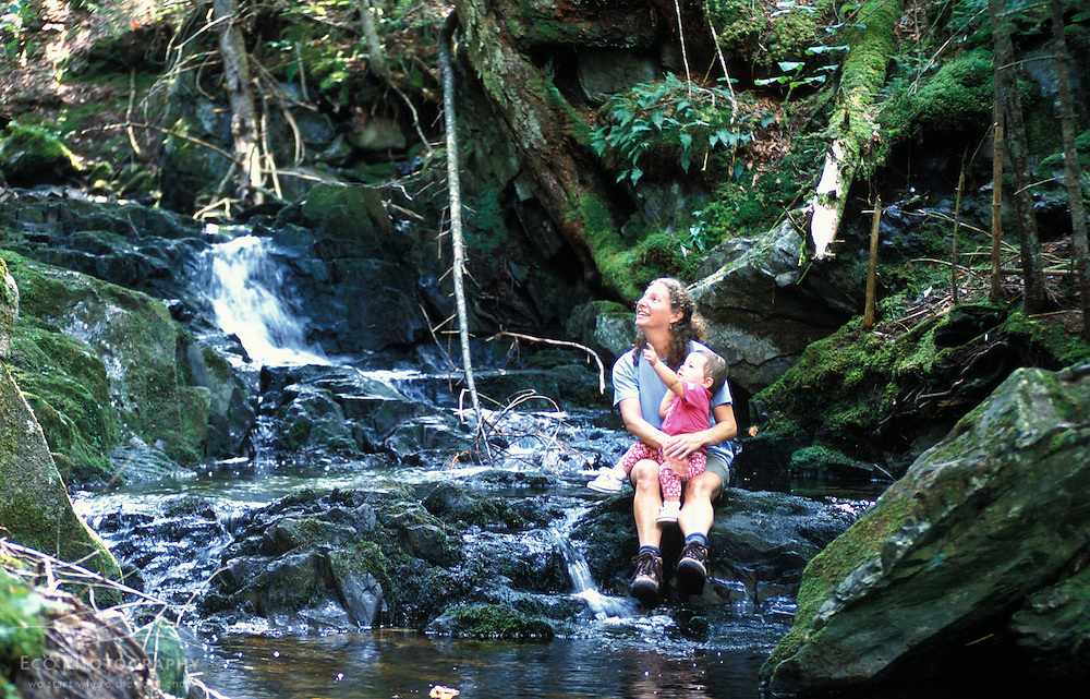 A mother and daughter enjoy the cascades on Tolman Brook on land currently owned by Hancock Timber.  Granby, VT