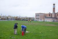 Children play soccer on a very muddy field in Portland, Oregon