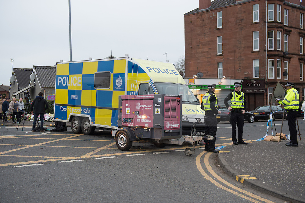 © Licensed to London News Pictures. 25/03/2016. <br /> <br /> Pictured: Police have closed off Minard Road where  Shah's Newsagents and Connivence store is located in The Shawlands Glasgow while forensic officers gather evidence.<br /> <br /> Police Scotland have arrested a 32 year old man in connection with the death of 40 year old shopkeeper Asad Shah after he was attacked outside his shop in Minard Road, The Shawlands, Glasgow on Thursday 24th March 2016.<br /> <br /> Police Scotland have announced they are treating the death as 'Religiously Prejudced'<br /> <br />  Photo credit should read Max Bryan/LNP