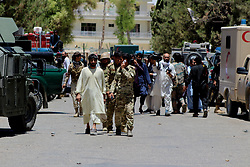 June 22, 2017 - Afghan security force members inspect the site of an attack in Helmand province, Afghanistan. At least 26 Afghans were killed and 59 others wounded when an explosion rocked a local bank office in Lashkar Gah city, capital of southern province of Helmand on Thursday, a local source said. (Credit Image: © Abduz Aziz Safdari/Xinhua via ZUMA Wire)