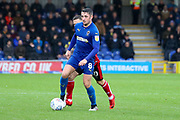 AFC Wimbledon midfielder Anthony Hartigan (8) battles for possession with Lincoln City attacker Jack Payne (10) during the EFL Sky Bet League 1 match between AFC Wimbledon and Lincoln City at the Cherry Red Records Stadium, Kingston, England on 2 November 2019.