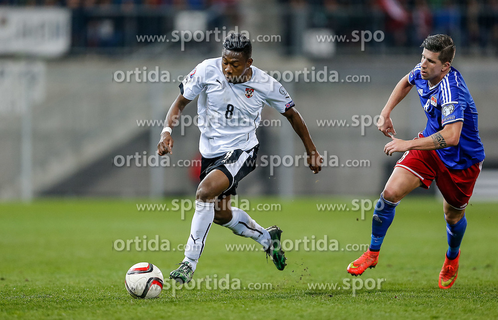 27.03.2015, Rheinpark Stadion, Vaduz, AUT, UEFA Euro 2016 Qualifikation, Liechtenstein vs Oesterreich, Gruppe G, im Bild David Alaba (Oesterreich) und Sandro Wieser (Liechtenstein)// during the UEFA EURO 2016 qualifier group G match between Liechtenstein and Austria at the Rheinpark Stadium, Vaduz, Liechtenstein on 2015/03/27. EXPA Pictures © 2015, PhotoCredit: EXPA/ Peter Rinderer
