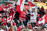 Fans cheer wildly as team Canada wins the Gold medal for hockey in the 2010 Olympic Winter Games in Whistler, BC Canada