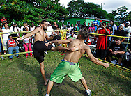 "In the ring fighters spar on September 18, 2010. Dhafir Harris, ""Dada 5000"", puts on backyard fights at his mother house, which go viral on youtube and have been the subject of documentaries. Sometimes the men fight until they are unconscious. There' s no gloves and occasionally, there's a cage. The community has taken to the events, because they are able to set up businesses selling food and washing cars."