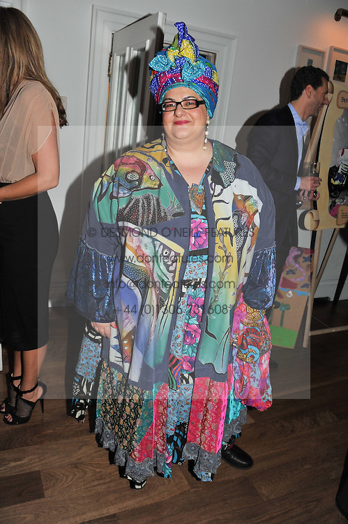 CAMILLA BATMANGEILEDH at a dinner hosted by Marlon and Nadya Abela in aid of Kids Company at Morton's, Berkeley Square, London on 25th September 2012.