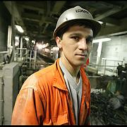 Stranieri in Piemonte lavoratore straniero nel cantiere della metro