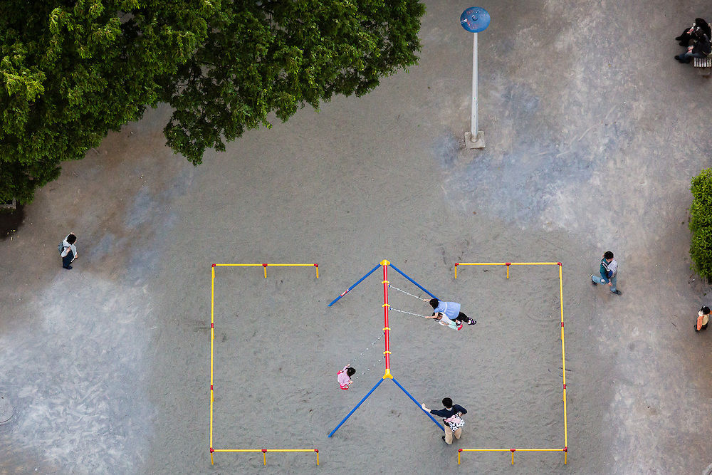 Girls play on a swing, seen from above, from the Bunkyo civic Center Observation Deck