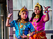 "29 APRIL 2017 - MINNEAPOLIS, MINNESOTA: Girls perform a dance from the Ramakien (Thai version of the Indian epic, the Ramayana) during Songkran Uptown. Several thousand people attended Songkran Uptown on Hennepin Ave in Minneapolis for the city's first celebration of Songkran, the traditional Thai New Year. Events included a Thai parade, a performance of the Ramakien (the Thai version of the Indian Ramayana), a ""Ladyboy"" (drag queen) show, and Thai street food.     PHOTO BY JACK KURTZ"