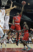 Western Kentucky Hilltoppers guard Josh Anderson (4) shoots the ball against the Southern California Trojans in the first half during an NCAA college basketball game in the second round of the NIT tournament in Los Angeles, Monday, Mar 19, 2018. WKU defeated USC 79-75.