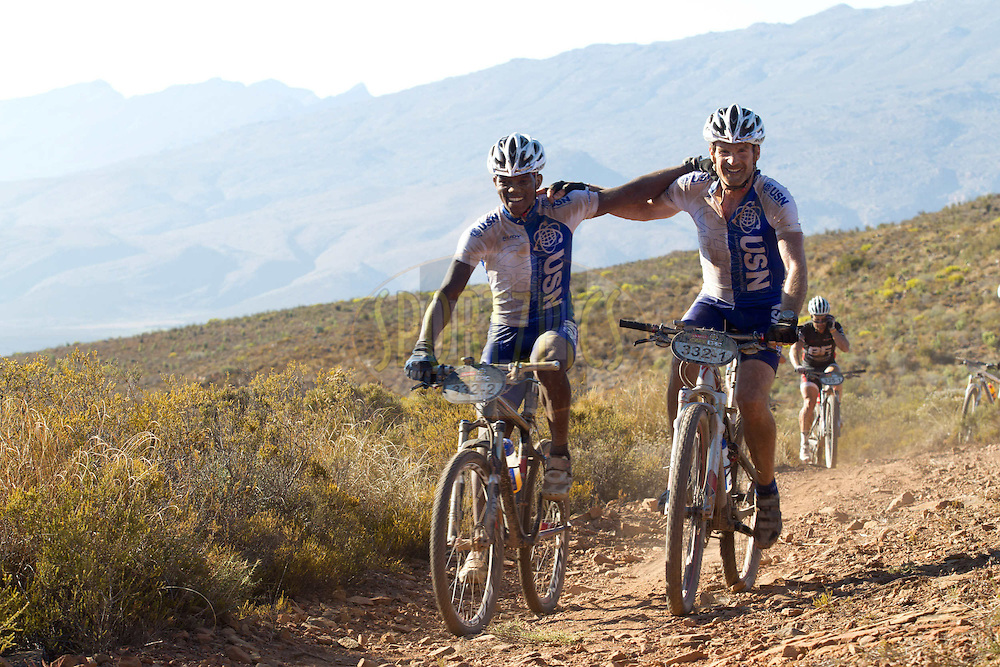 Legend canoeist Martin Dreyer and team-mate John Ntuli of team USN celebrate after the first climb during stage 3 of the 2012 Absa Cape Epic Mountain Bike stage race held from Robertson Primary School in Robertson to Overberg Primary & High School in Caledon, South Africa on the 28 March 2012..Photo by Greg Beadle/Cape Epic/SPORTZPICS