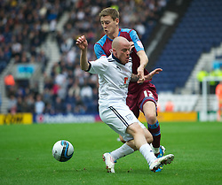 PRESTON, ENGLAND - Saturday, September 24, 2011: Tranmere Rovers' Ash Taylor in action against Preston North End's Iain Hume during the Football League One match at Deepdale. (Pic by Dave Kendall/Propaganda)